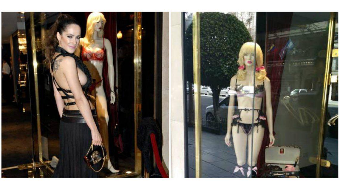 Victoria Vannucci, en plena calle Alvear acomodando la vidriera de su marca