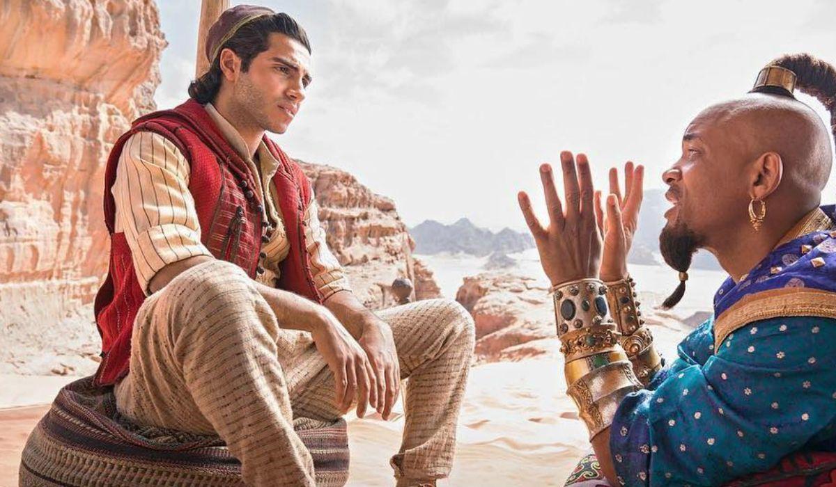 Mena Massoud como Aladdin y Will Smith como El Genio